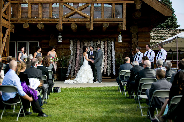 outside wedding ceremony photographed from the back guest seated