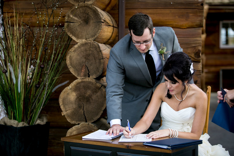 bride and groom signing of the registry