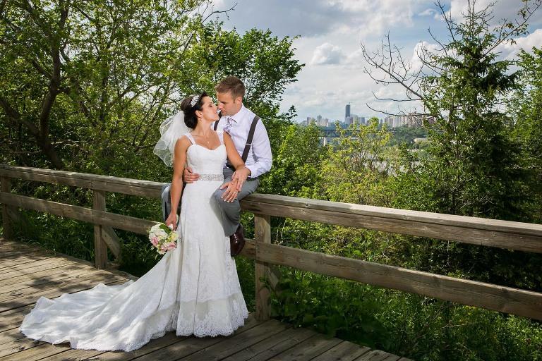 bride and groom in front of edmonton landscape