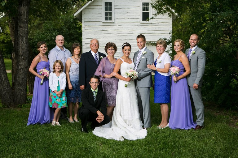 family formal photograph at a wedding